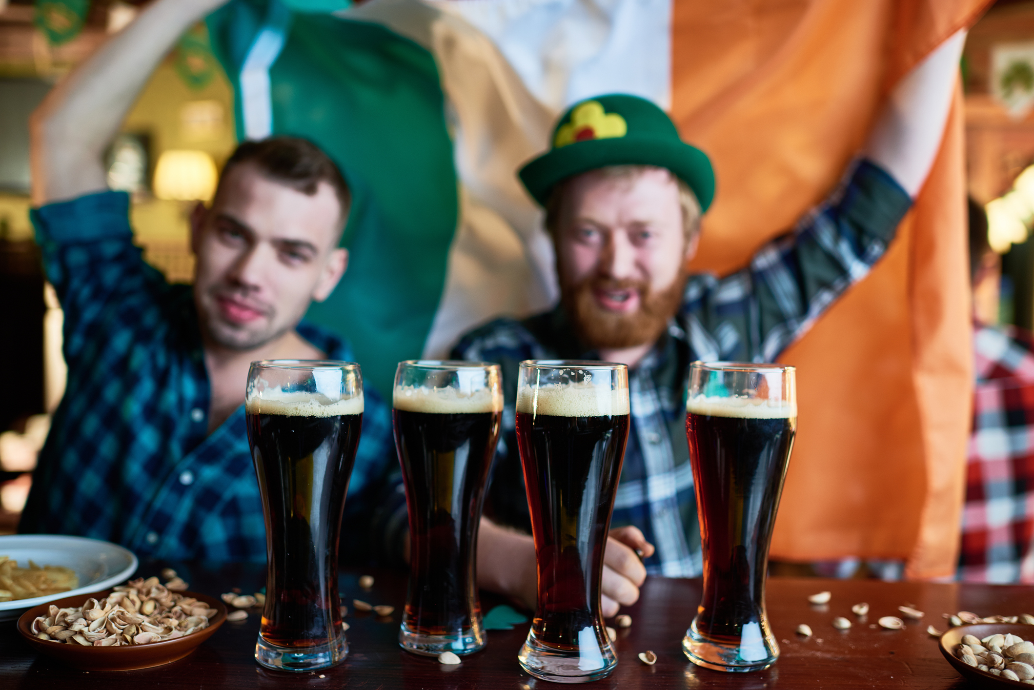 Friends drinking beer together on St.Patrick's Day